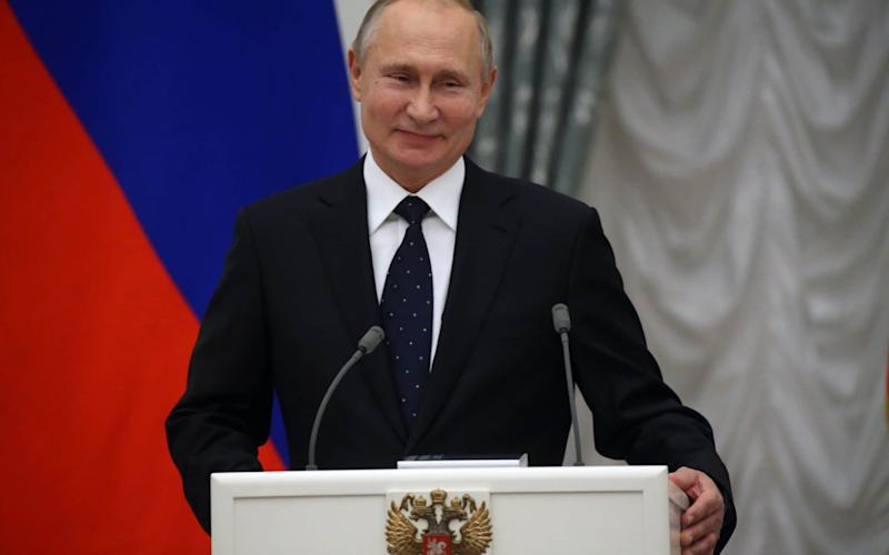 Russian President Vladimir Putin late on Monday signed into law an amendment that could require bloggers and independent journalists to register as foreign agents - Getty Images Europe