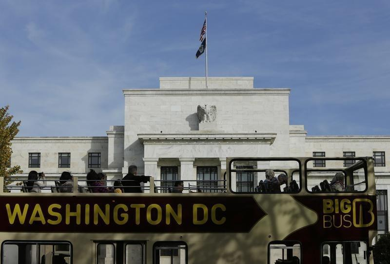 A tour bus passes the United States Federal Reserve Board building in Washington