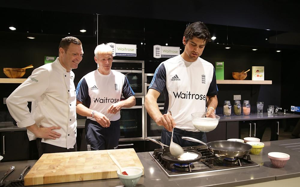 Alastair Cook takes part in a cooking lesson during the Waitrose official sponsorship launch of England Cricket at the Waitrose Cookery School on May 1, 2014 in London - Credit: Getty