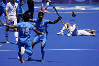 India's Nilakanta Sharma (18) and Sumit (17) celebrate as Germany's Lukas Windfeder, right, reacts after India won their men's field hockey bronze medal match 5-4 at the 2020 Summer Olympics, Thursday, Aug. 5, 2021, in Tokyo, Japan. (AP Photo/John Locher)