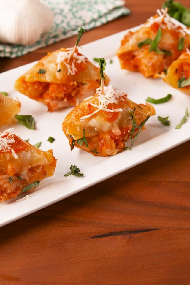 """<p>How have we not done this sooner?</p><p>Get the recipe from <a href=""""https://www.delish.com/cooking/recipe-ideas/recipes/a58002/chicken-parm-stuffed-shells-recipe/"""">Delish</a>.</p>"""