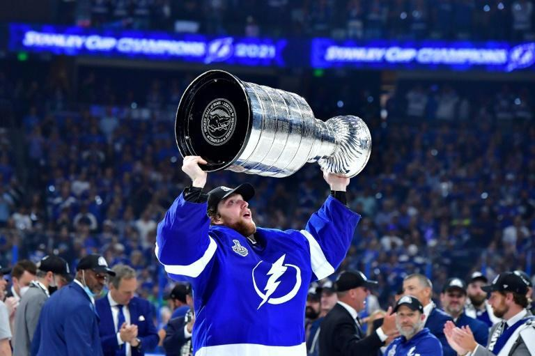 Tampa Bay goaltender Andrei Vasilevskiy hoists the Stanley Cup after the Lightning beat the Montreal Canadiens 1-0 to seal a 4-1 victory in the NHL championship series