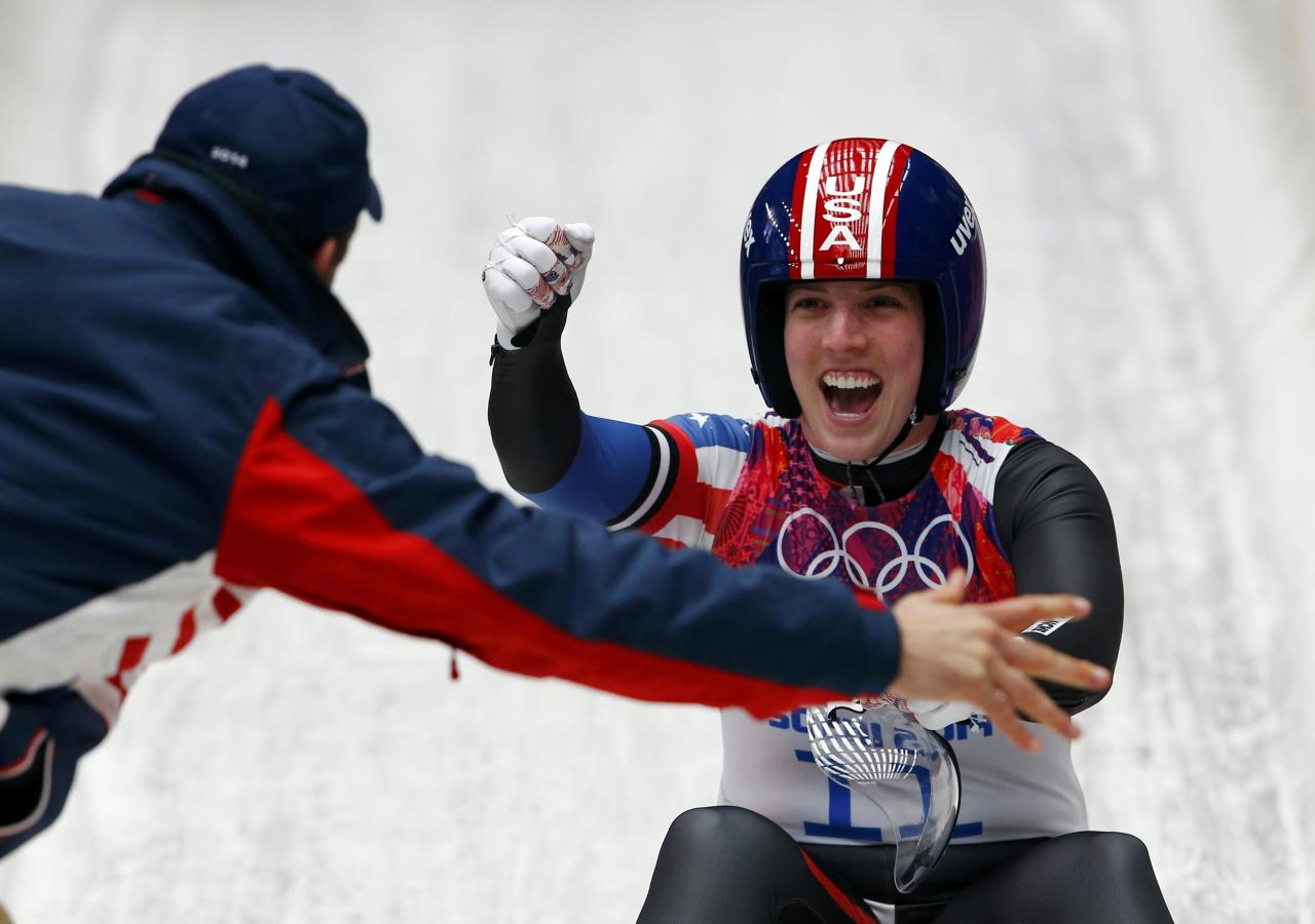 Erin Hamlin of the U.S. celebrates after finishing her final run in the women's luge singles competition during the 2014 Sochi Winter Olympics, February 11, 2014. REUTERS/Arnd Wiegmann (RUSSIA - Tags: SPORT LUGE OLYMPICS)