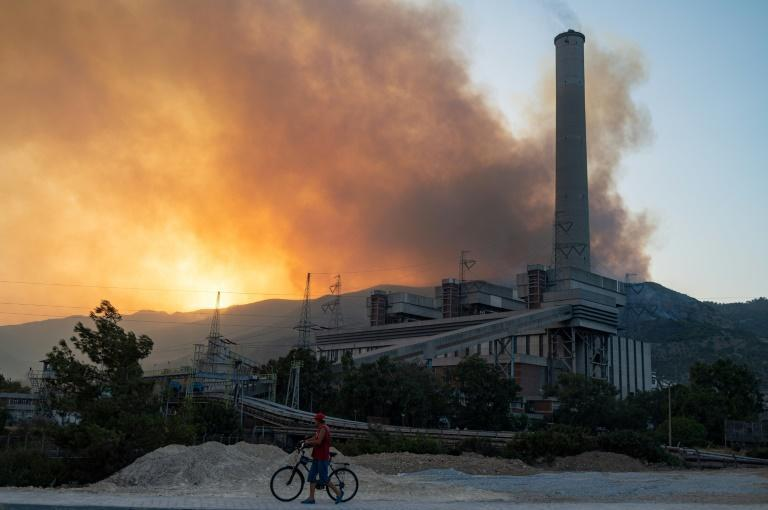 """The regional mayor said """"there's a risk that the fire could spread to the thousands of tonnes of coal inside"""" the power plant"""