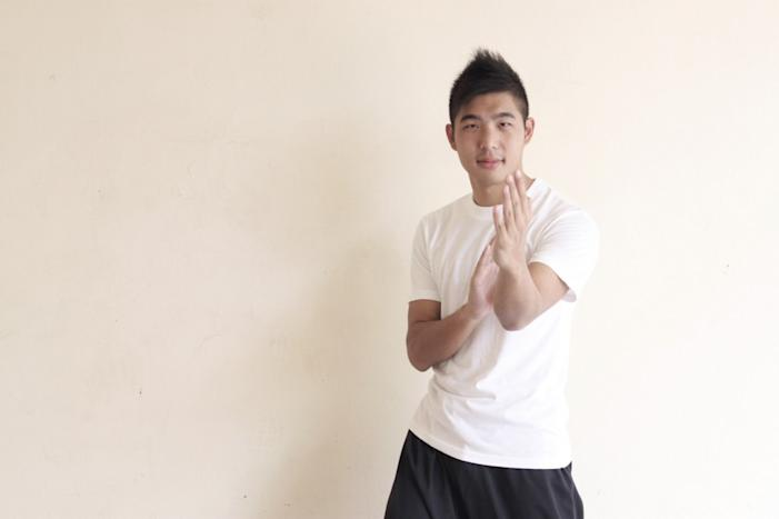 Instructor Daryl Yeo strikes the Mun Sau pose. (Image Credit: Emily Mok)