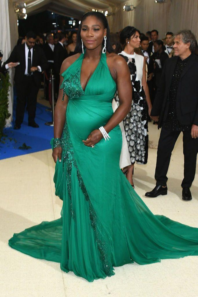 <p>While pregnant, Williams wore an emerald green Versace gown to the 2017 Met Gala.</p>