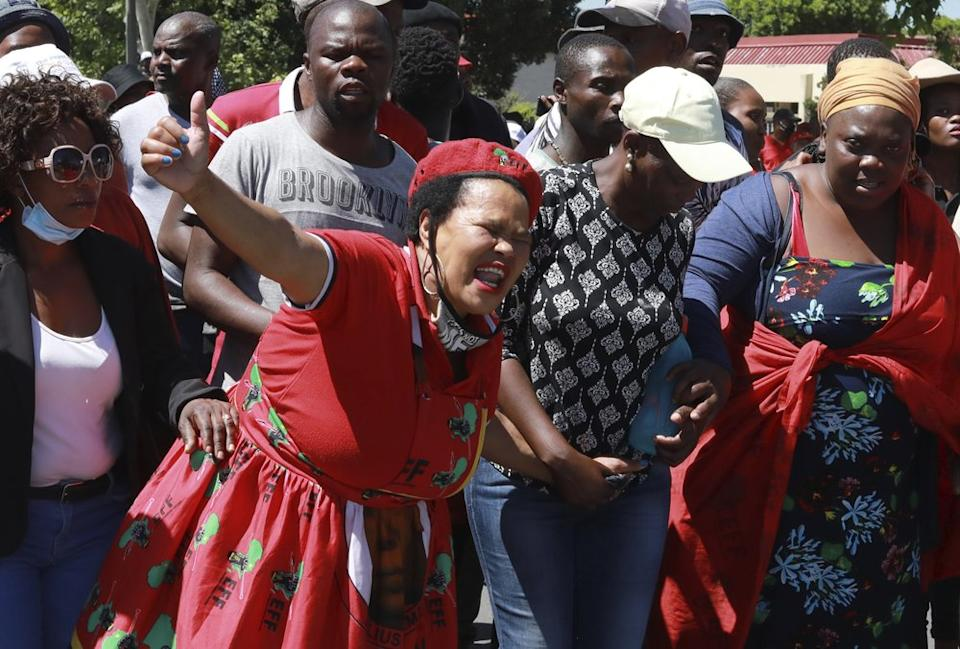 Members of the Economic Freedom Fighters (EFF) protest near the Brackenfell High school in Cape Town, South Africa, Friday, Nov. 20, 2020. (AP Photo/Nardus Engelbrecht)