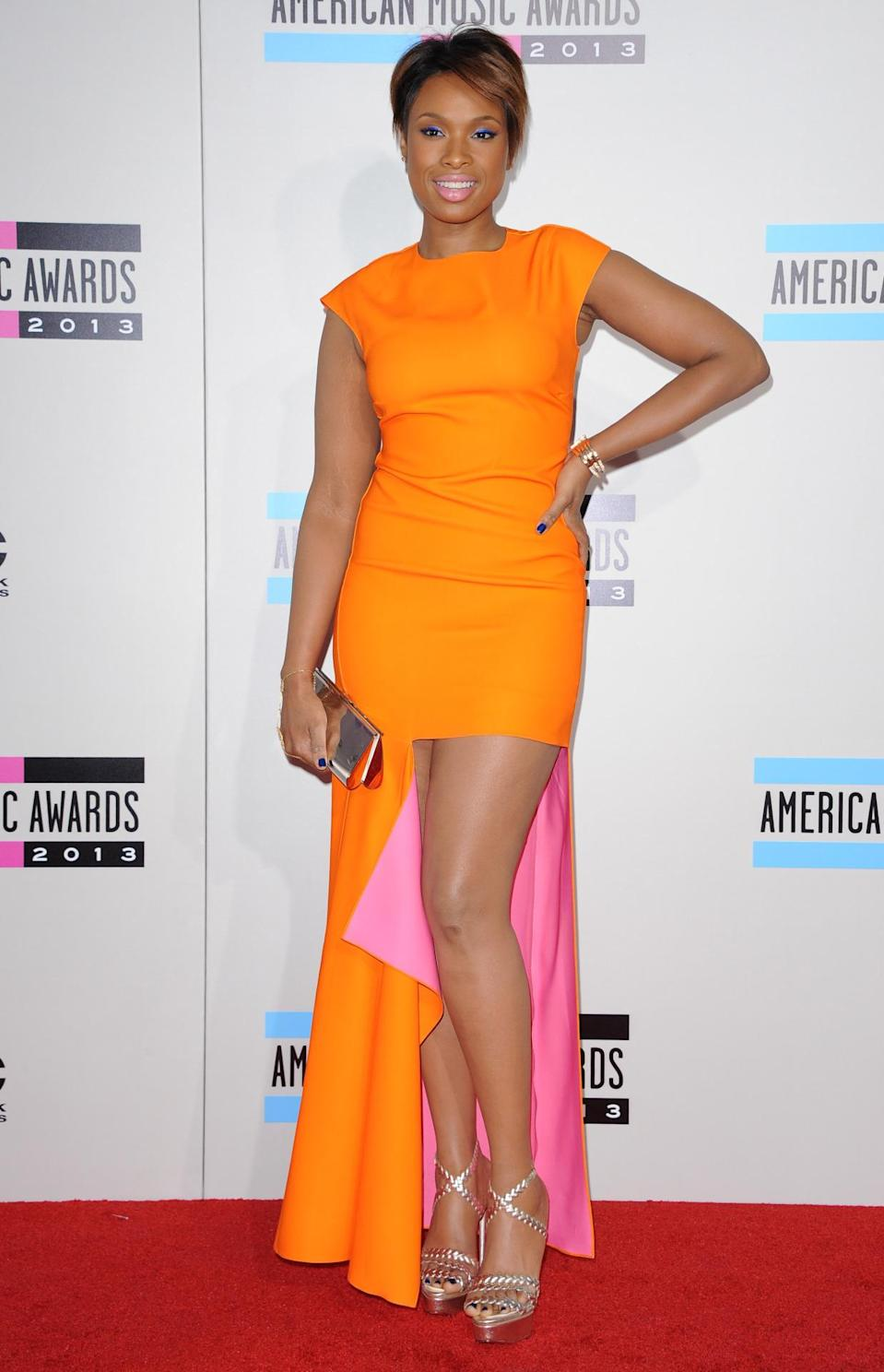 The Dior dress Jennifer Hudson wore to the American Music Awards in 2013 was all orange except for the pink lining, which was visible because of the torn up aspect.
