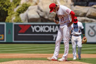Los Angeles Angels pitcher Shohei Ohtani, of Japan, stands on the mound before being taken out of the game after walking in his second run during the second inning of a baseball game against the Houston Astros Sunday, Aug. 2, 2020, in Anaheim, Calif. (AP Photo/Mark J. Terrill)