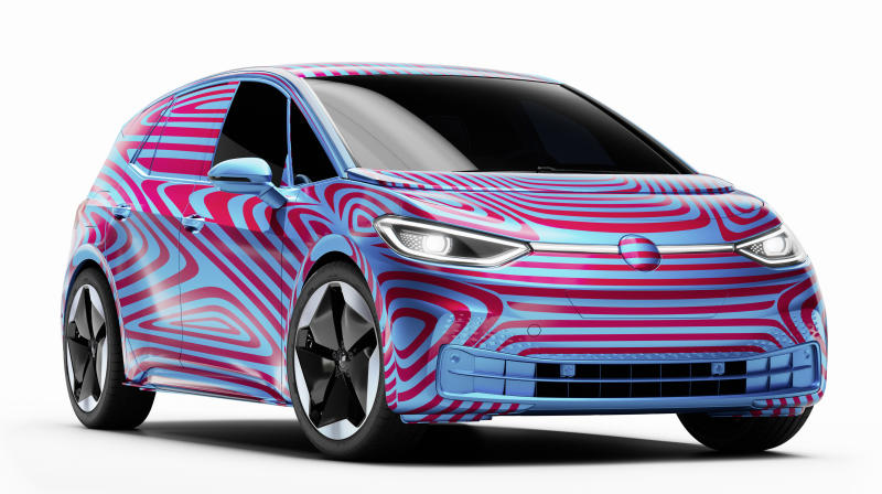 A preproduction Volkswagen ID.3, an electric hatchback, shown wrapped in blue and red camouflage.