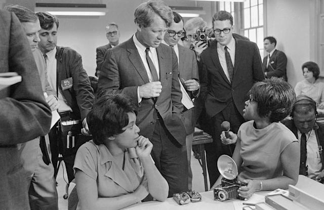 <p>Kennedy talks with students as he tours the Manpower Development and Training Center at Greenville, Miss., April 12, 1967. (Photo: Jack Thornell/AP) </p>