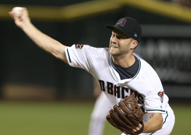 FILE - In this Friday, Sept. 7, 2018 file photo, Arizona Diamondbacks closer Brad Boxberger throws against the Atlanta Braves during the ninth inning of a baseball game in Phoenix. A person familiar with the deal tells The Associated Press the Kansas City Royals have agreed to a $2.2 million, one-year deal with reliever Brad Boxberger. The person spoke on condition of anonymity Wednesday, Feb. 6, 2019 because the agreement was pending a successful physical. (AP Photo/Ralph Freso, File)