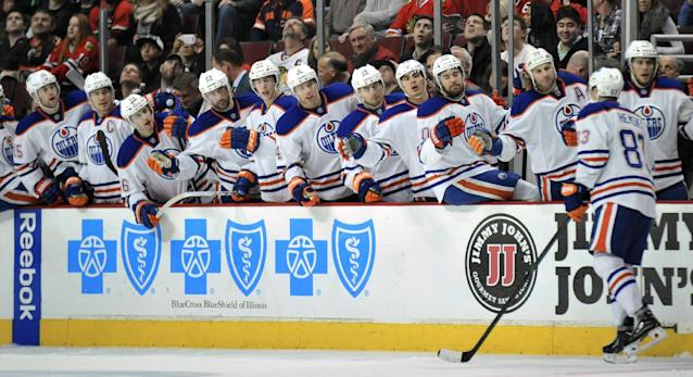 Edmonton Oilers' Ales Hemsky (83), celebrates with teammates after scoring during the first period of an NHL hockey game against the Chicago Blackhawks in Chicago, Sunday, Jan., 12, 2014. (AP Photo/Paul Beaty)