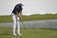 Cameron Tringale makes his final putt on the 18th hole to take the lead at 12 under par during the third round of the 3M Open golf tournament in Blaine, Minn., Saturday, July 24, 2021. (AP Photo/Craig Lassig)