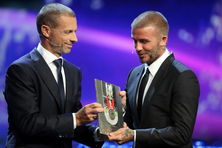 UEFA president Ceferin (L) presenting David Beckham with an award in Monaco on Thursday