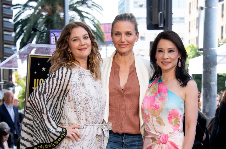 Actress Drew Barrymore (L), Cameron Diaz (C) and Lucy Liu (R) stand on the star during Liu's Walk of Fame ceremony in Hollywood on May 1, 2019. - Lucy Liu's star is the 2,662nd star on the Hollywood Walk Of Fame in the Category of Television. (Photo by VALERIE MACON / AFP)        (Photo credit should read VALERIE MACON/AFP/Getty Images)