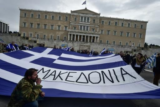 """A Greek flag reading """"Macedonia"""" held at a demonstration in Greece earlier this year urging the government not to compromise on the festering name row"""
