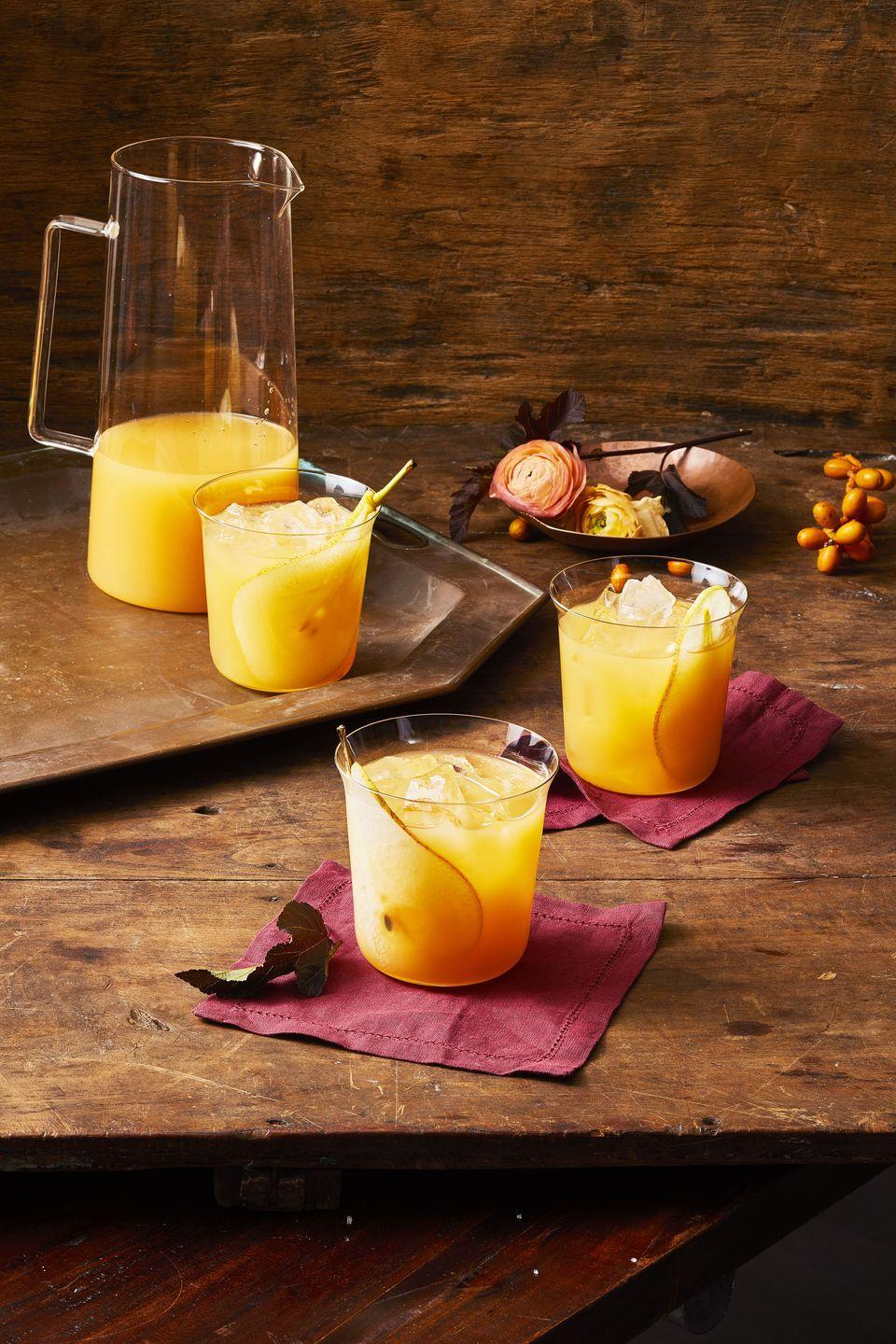 """<p>Sweet pear nectar gets kicked-up with spiced rum and ginger beer. Talk about a one-two punch.</p><p><em><a href=""""https://www.goodhousekeeping.com/food-recipes/party-ideas/a29417605/fall-punch-recipe/"""" rel=""""nofollow noopener"""" target=""""_blank"""" data-ylk=""""slk:Get the recipe for Fall Punch »"""" class=""""link rapid-noclick-resp"""">Get the recipe for Fall Punch »</a></em></p>"""
