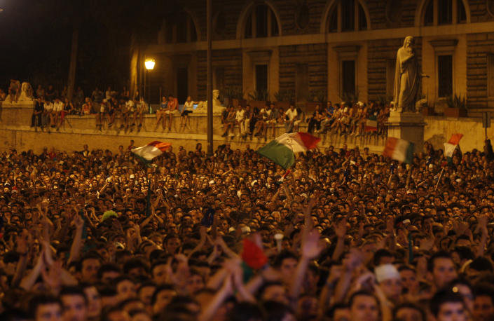 Italian soccer fans celebrate in Piazza del Popolo square in Rome, after Italy's second goal against Germany in the Euro 2012 soccer championship semifinal match Thursday, June 28, 2012. (AP Photo/Alessandra Tarantino)