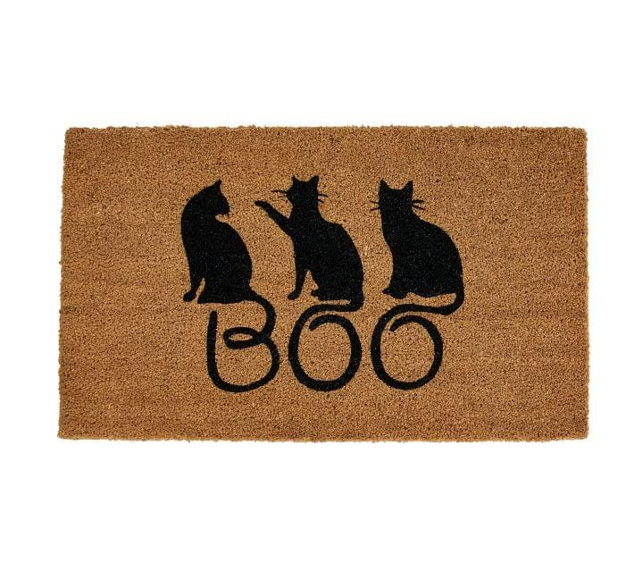 "<p>Give your dorm an extra cozy touch with this coir <a href=""https://www.popsugar.com/buy/Boo%20Cats%20Doormat-471972?p_name=Boo%20Cats%20Doormat&retailer=potterybarn.com&price=18&evar1=casa%3Aus&evar9=46409132&evar98=https%3A%2F%2Fwww.popsugar.com%2Fhome%2Fphoto-gallery%2F46409132%2Fimage%2F46409144%2FBoo-Cats-Doormat&list1=halloween%2Ccollege%2Challoween%20decor%2Cdorms&prop13=api&pdata=1"" rel=""nofollow"" data-shoppable-link=""1"" target=""_blank"" class=""ga-track"" data-ga-category=""Related"" data-ga-label=""http://www.potterybarn.com/products/boo-cats-doormat/"" data-ga-action=""In-Line Links"">Boo Cats Doormat</a> ($18, originally $20) featuring spooky black cats whose tails spell out the season's greeting!</p>"