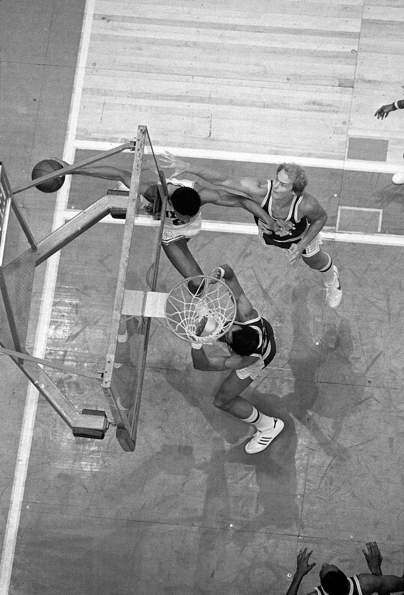 PHILADELPHIA - MAY 11: Julius Erving #6 of the Philadelphia 76ers drives to the basket in what becomes known as 'The Move' against Mark Landsberger #54 and Kareem Abdul-Jabbar #33 of the Los Angeles Lakers during game 4 of the NBA Finals on May 11 of the 1980 NBA Finals at The Spectrum in Philadelphia, Pennsylvania. NOTE TO USER: User expressly acknowledges and agrees that, by downloading and or using this photograph, User is consenting to the terms and conditions of the Getty Images License Agreement. (Photo by Jim Cummins/ NBAE/ Getty Images)