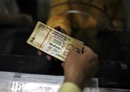 A man deposits his money in a bank in Amritsar