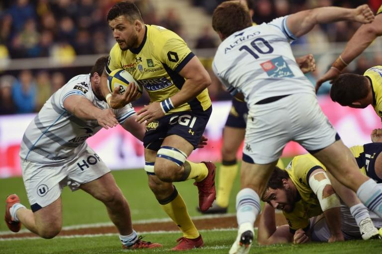 Clermont's flanker Damien Chouly (2L) tries to escape the tackle from Montpellier players during the French Top 14 rugby union match ASM Clermont vs MHR Montpellier at the Michelin stadium in Clermont-Ferrand, central France, on March 12, 2017
