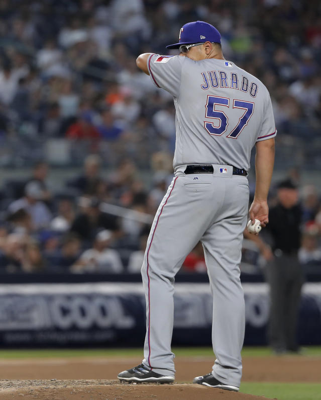 Texas Rangers starting pitcher Ariel Jurado (57) reacts after giving up a two-run home run to New York Yankees' Miguel Andujar during the fourth inning of a baseball game, Thursday, Aug. 9, 2018, in New York. (AP Photo/Julie Jacobson)