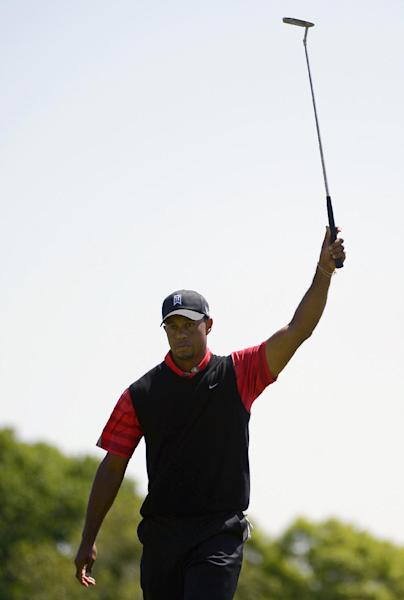 Tiger Woods reacts as he sinks a putt for birdie on the 12th green during the final round of the Arnold Palmer Invitational golf tournament in Orlando, Fla., Monday, March 25, 2013. (AP Photo/Phelan M. Ebenhack)