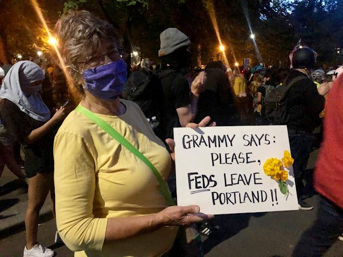 Mardy Widman, a 79-year-old grandmother of five, protests the presence of federal agents outside the Mark O. Hatfield Federal Courthouse in Portland, Oregon, Monday, July 20, 2020. Widman said this was her first time protesting since George Floyd's death because of her fear of the coronavirus but the Trump administration's decision to send federal agents to Portland motivates her to come.