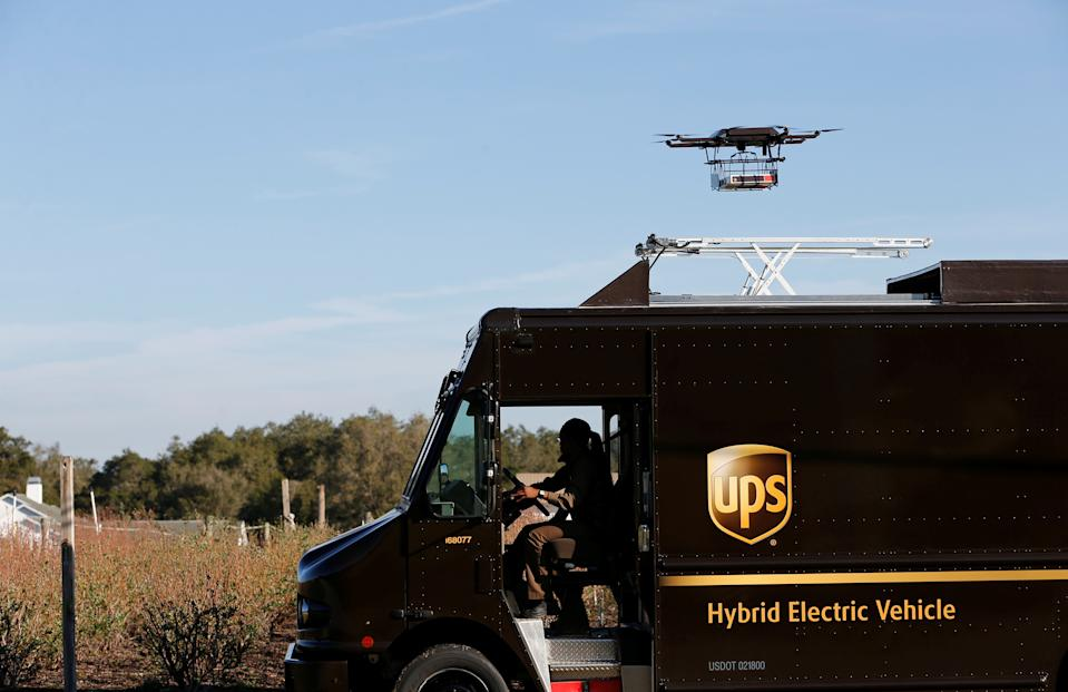 A drone demonstrates delivery capabilities from the top of a UPS truck during testing in Lithia, Florida, U.S. February 20, 2017. REUTERS/Scott Audette     TPX IMAGES OF THE DAY