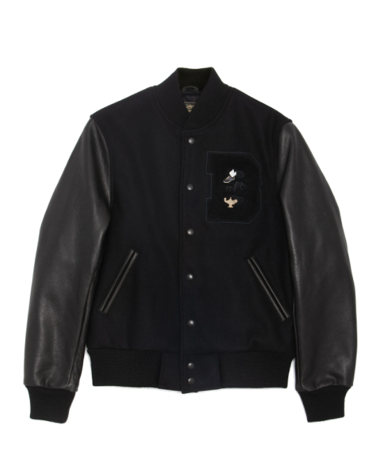 """<p><strong>THE BROOKLYN CIRCUS</strong></p><p>thebkcircus.com</p><p><strong>$550.00</strong></p><p><a href=""""https://thebkcircus.com/collections/new-arrivals-11-17/products/bkc-black-cotton-magic-varsity-jacket?variant=31222812475528"""" rel=""""nofollow noopener"""" target=""""_blank"""" data-ylk=""""slk:Shop Now"""" class=""""link rapid-noclick-resp"""">Shop Now</a></p><p>The Brooklyn Circus/BKc is a bespoke menswear brand taking NYC street style (and <a href=""""https://www.instagram.com/thebkcircus/"""" rel=""""nofollow noopener"""" target=""""_blank"""" data-ylk=""""slk:the internet"""" class=""""link rapid-noclick-resp"""">the internet</a>) by storm. The main attraction? Old-school varsity jackets. </p><p>This season's newcomer, the Triple Black Bomber, sports every single detail in black — the cow leather sleeve, melton wool body, and chenille patch. The jacket even comes with BKc's signature pins, which you can apply to your liking. It's absolutely worth the hype.</p>"""