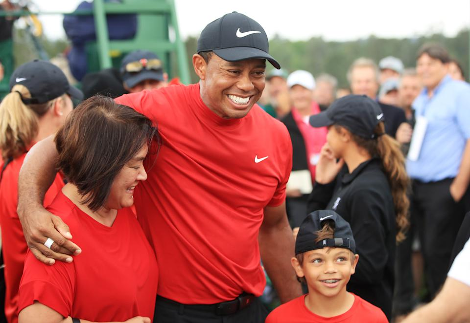 Tiger Woods of the United States celebrates with his son Charlie Axel as he comes off the 18th hole in honor of his win during the final round of the Masters at Augusta National Golf Club on April 14, 2019 in Augusta, Georgia. (Photo by Andrew Redington/Getty Images)