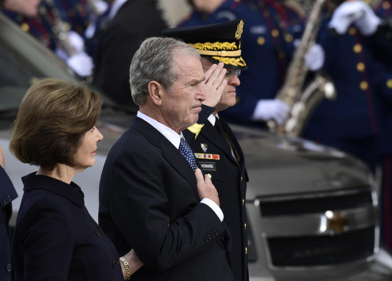 George W. Bush is seen beside his wife, Laura Bush, as the casket of his late father arrives at the National Cathedral. (ASSOCIATED PRESS)