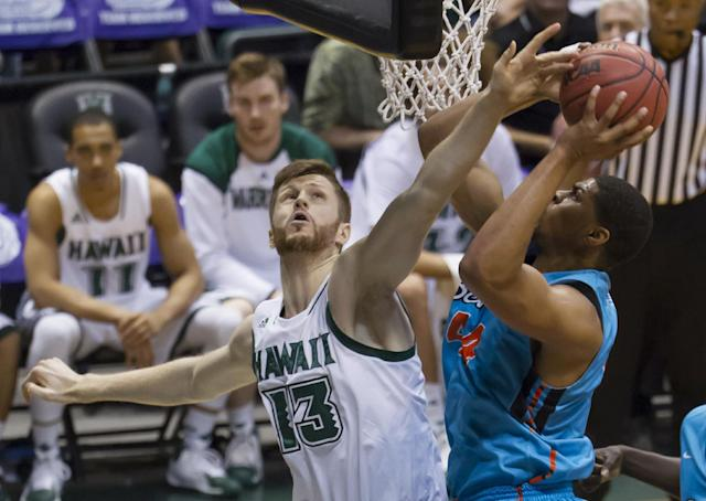 Hawaii center Davis Rozitis (13) attempts to block the shot of Oregon State forward Devon Collier during the first half of an NCAA college basketball game at the Diamond Head Classic on Wednesday, Dec. 25, 2013, in Honolulu. (AP Photo/Eugene Tanner)