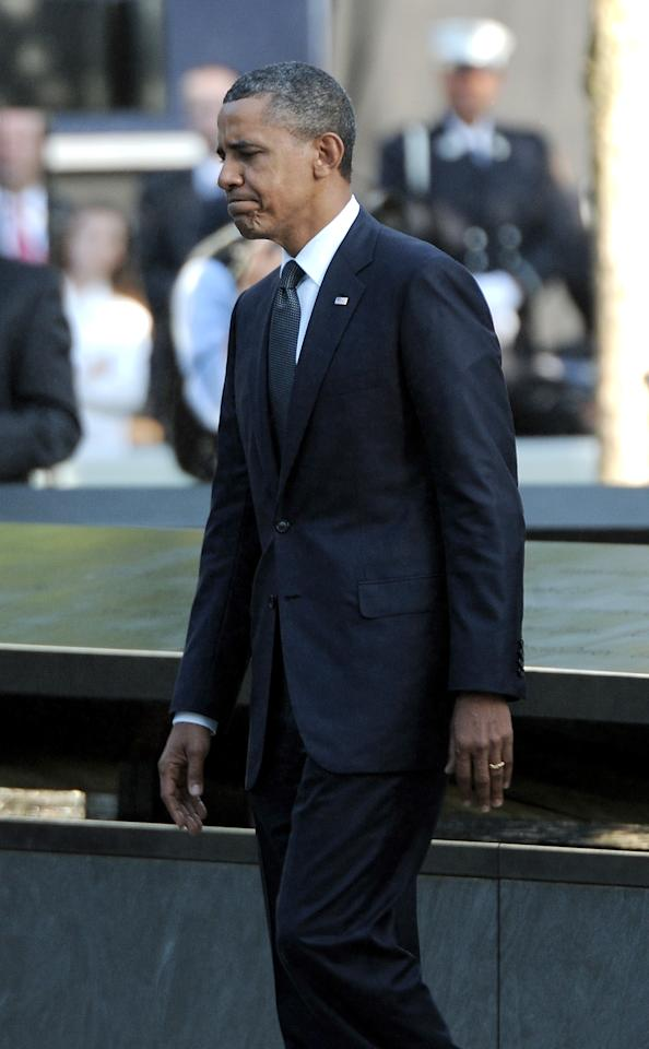 President Barack Obama walks past the north reflecting pool of the Sept. 11 memorial during 10th anniversary ceremonies at the site, Sunday, Sept. 11, 2011, in New York. (AP Photo/Justin Lane, Pool)