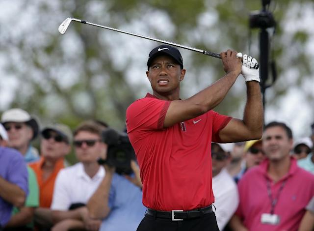 Tiger Woods tees off on the fourth hole during the final round of the Cadillac Championship golf tournament Sunday, March 9, 2014, in Doral, Fla. (AP Photo/Lynne Sladky)