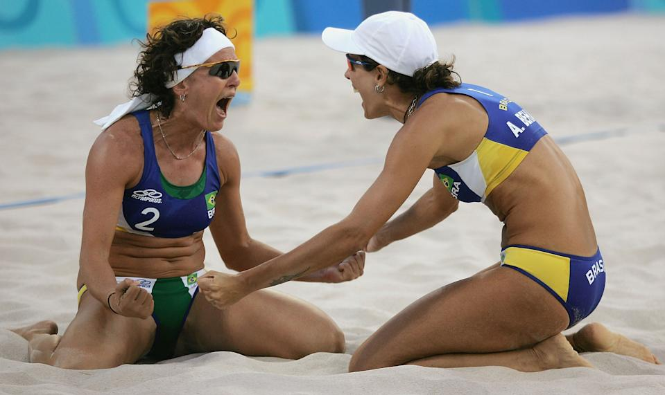 ATHENS - AUGUST 23: Shelda Bede #2 and Adriana Behar #1 for Brazil celebate after winning the women's semifinal match between Australia and Brazil on August 23, 2004 during the Athens 2004 Summer Olympic Games at the Olympic Beach Volleyball Centre at the Faliro Coastal Zone Complex in Athens, Greece. (Photo by Sean Garnsworthy/Getty Images)