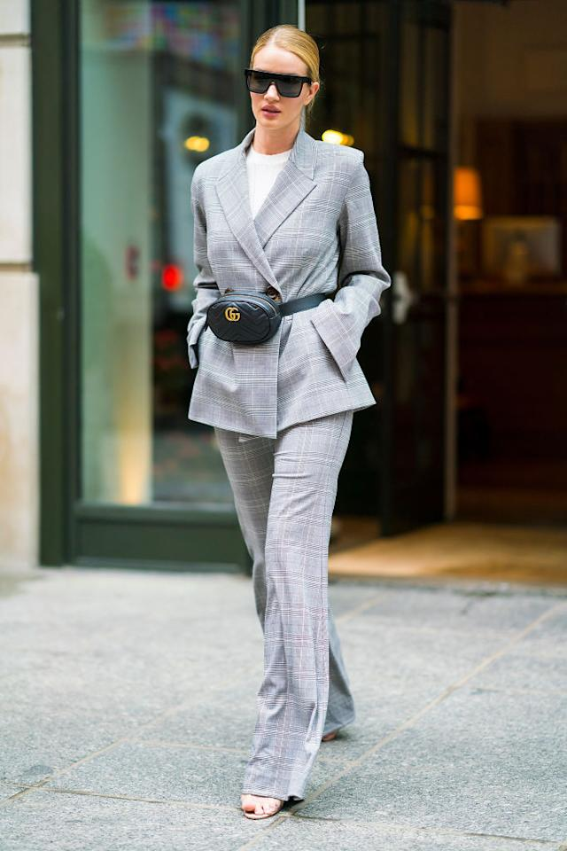 <p>Rosie Huntington-Whiteley stepped out in Soho this week rocking a highly covetable Acne suit and Gucci bum bag. One word: want. <em>[Photo: Getty]</em> </p>