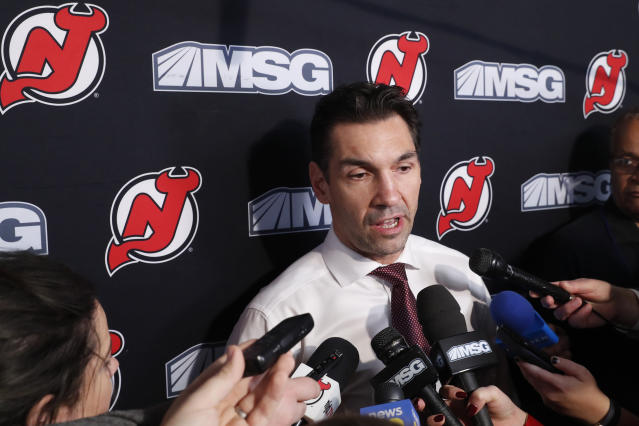 New Jersey Devils interim coach Alain Nasreddine speaks to members of the media before an NHL hockey game against the Vegas Golden Knights, Tuesday, Dec. 3, 2019, in Newark, N.J. The Devils fired head coach John Hynes earlier in the day. (AP Photo/Kathy Willens)