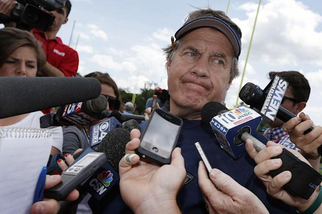 New England Patriots head coach Bill Belichick talks with reporters following NFL football minicamp in Foxborough, Mass., Wednesday, June 18, 2014. (AP Photo/Michael Dwyer)