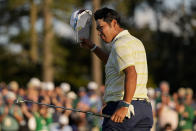 Hideki Matsuyama, of Japan, tips his cap after winning the Masters golf tournament on Sunday, April 11, 2021, in Augusta, Ga. (AP Photo/Matt Slocum)