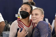 Gold medallist Sunisa Lee of the Unites States celebrates with teammate Jade Carey at the end of the artistic gymnastics women's all-around at the 2020 Summer Olympics, Thursday, July 29, 2021, in Tokyo. (AP Photo/Gregory Bull)