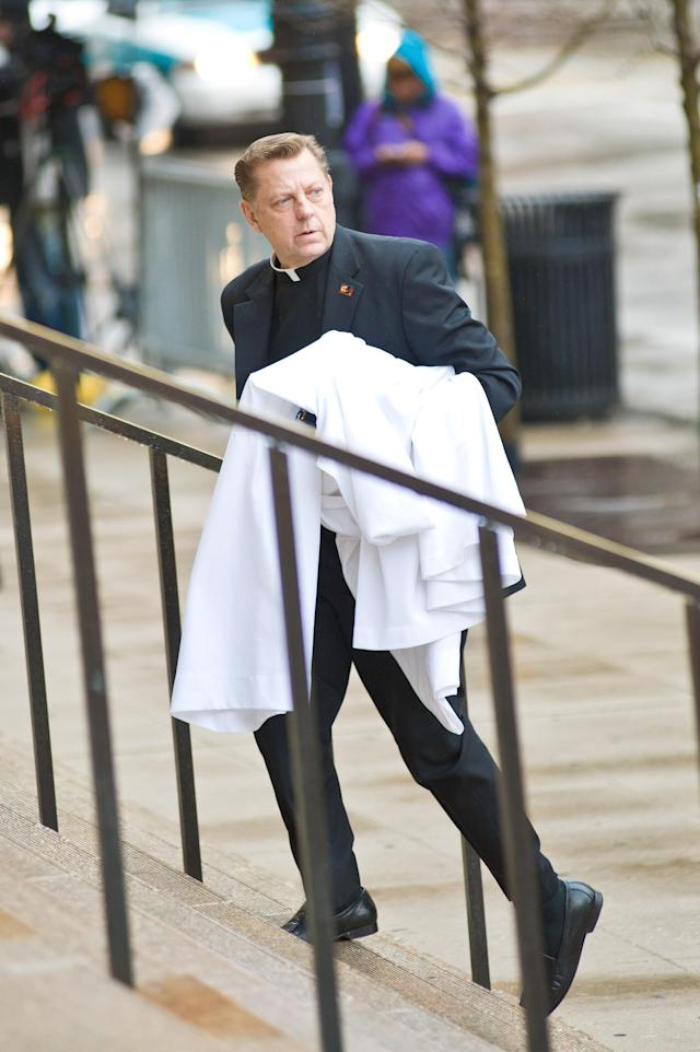 CHICAGO, IL - APRIL 08: Father Michael Pfleger attends funeral services for Roger Ebert at Holy Name Cathedral on April 8, 2013 in Chicago, Illinois. (Photo by Timothy Hiatt/Getty Images)