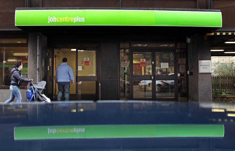BATH, ENGLAND - JANUARY 18: People enter the Jobcentre Plus office on January 18, 2012 in Bath, England. Figures released today show that the UK unemployment rate has risen to a 17-year high increasing by 118,000 in the three months between September and November, taking the total jobless count to 2.685 million. (Photo by Matt Cardy/Getty Images)