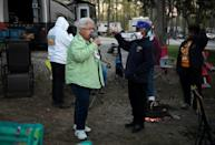 Members of RVing Women, including Loretta Veney (R), who joined the organization following her husband's death, find camaraderie in their shared love for campers
