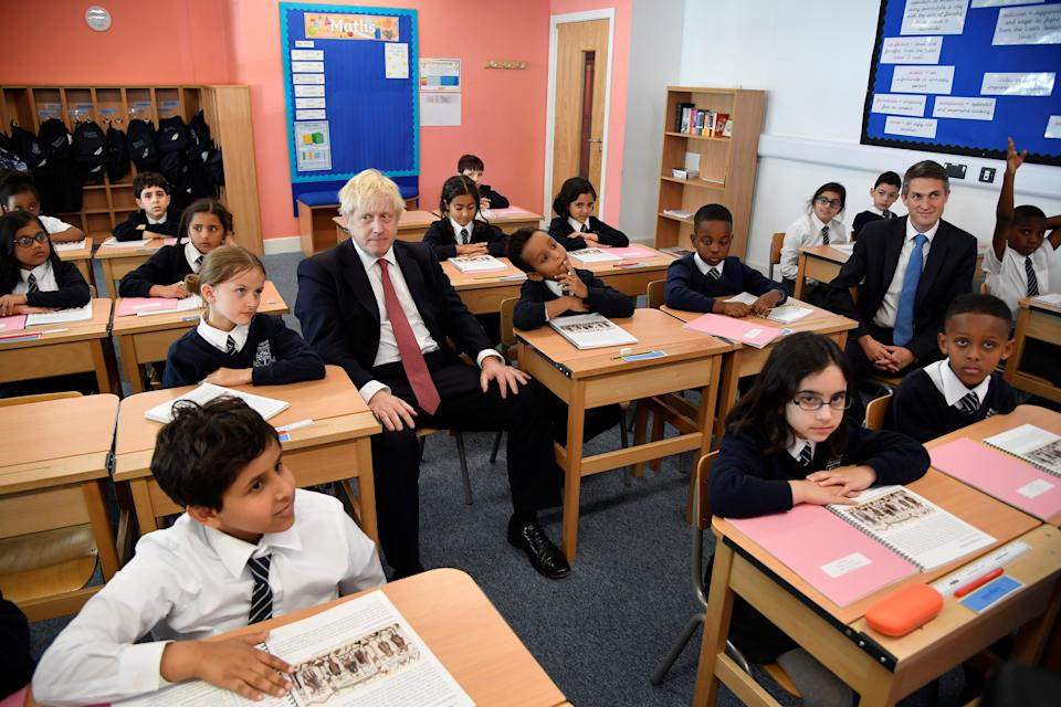 LONDON, UNITED KINGDOM - SEPTEMBER 10:  Britain's Prime Minister Boris Johnson attends a year six history class with pupils during a visit to Pimlico Primary school on September 10, 2019 in London, England. Parliament has now been suspended for five weeks. Boris Johnson's vote to call an early election in October was defeated in the Commons for a second time.  (Photo by Toby Melville/WPA Pool/Getty Images)
