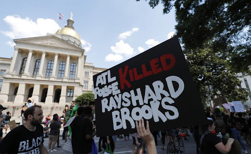 Protesters march near the Georgia Capitol after an Atlanta Police Department officer was involved shooting which left a black man, Rayshard Brooks, 27, dead. Source: EPA