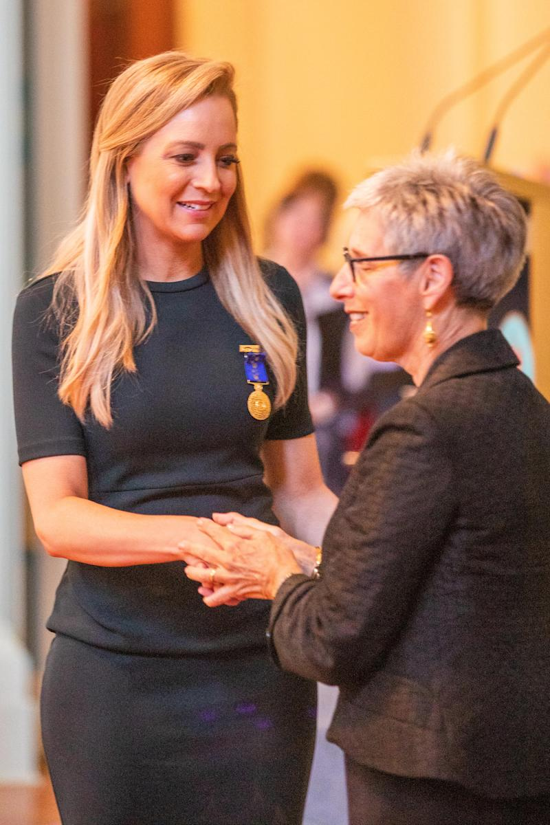 Carrie Bickmore (L) receives her 2019 Queen's Birthday Honour medal from Governor of Victoria, Linda Dessau (R) during the Queen's Birthday Investiture Ceremony at Government House on September 17, 2019 in Melbourne, Australia. The Australian Honours recipients are being recognised for their outstanding contributions in their respective fields.