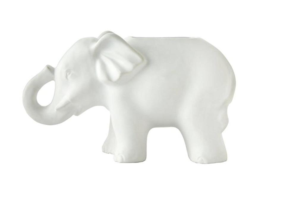 <p>Attention, wildlife enthusiasts: This elephant-shaped <span>Vern Kip by SKL Home Shangri La Toothbrush Holder</span> ($27) is on sale at Kohl's. The unadorned white stone material allows the sculpture to speak for itself.</p>